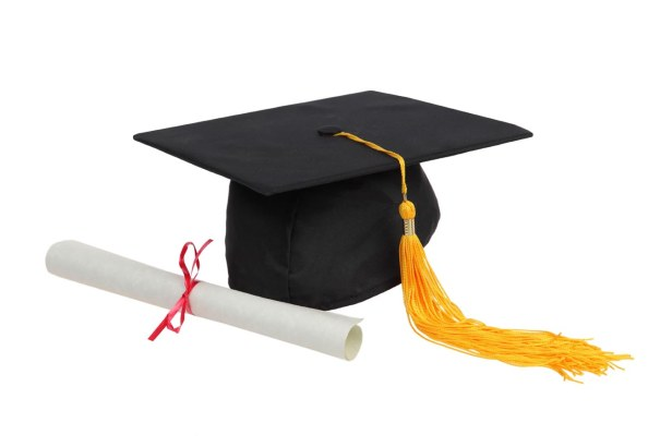 Graduation hat and diploma on white background